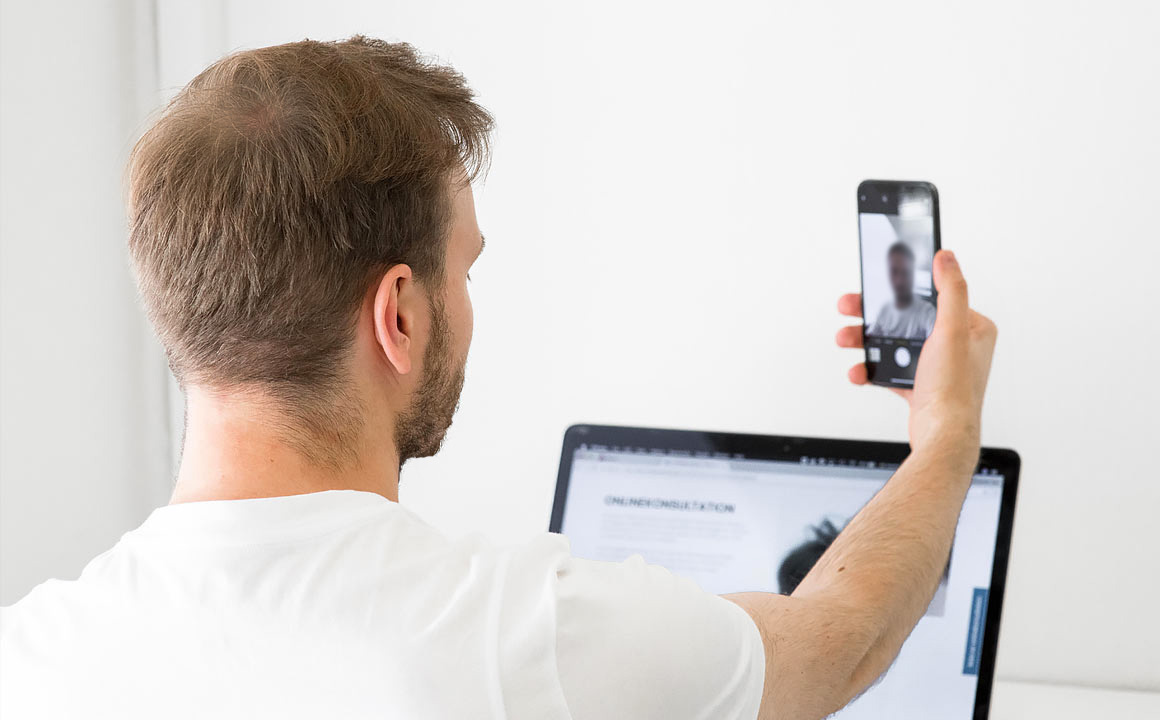 A person takes selfie of hair to send in for online consultation